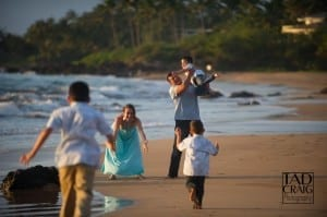 Parents catching their kids on a Maui beach