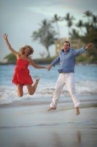 Honeymooners leaping with Joy