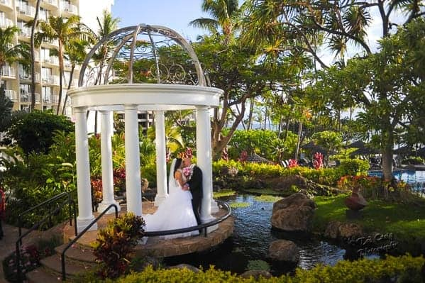 bride and groom kissing under the Hale Aloha Gazebo at the Westin Maui Resort & Spa