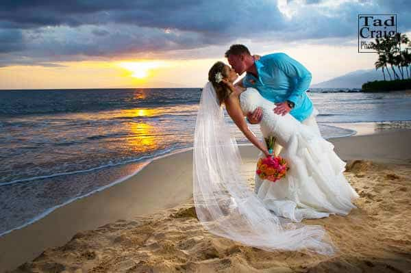groom kissing bride at sunset on Maui, Hawaii