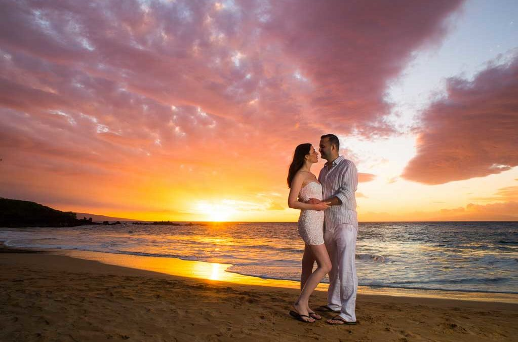 Just married couple kissing at their amazing wedding venue at sunset