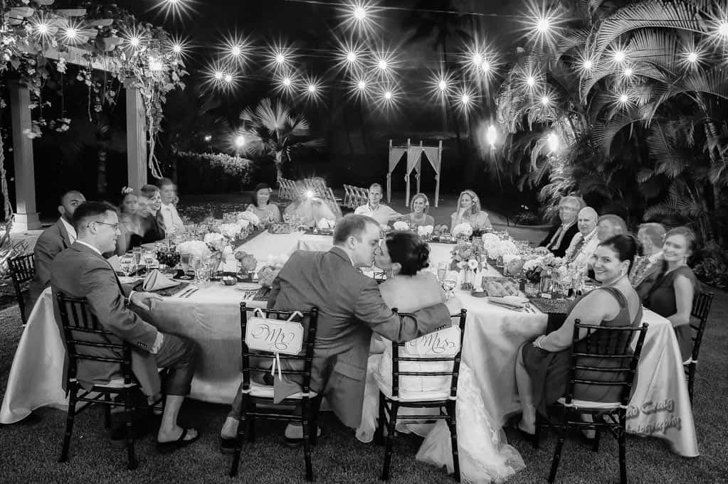 Couple kissing at reception table